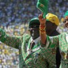 epa03805393 Zimbabwean President Robert Mugabe (L) and his wife Grace (R) arrive at the National Sports Stadium for an election campaign rally in the capital Harare, Zimbabwe, 28 July 2013. This was Zimbabwe African National Union'??Patriotic Front (ZANU-PF) president Mugabe's final campaign rally ahead of presidential elections on 31 July.  EPA/AARON UFUMELI